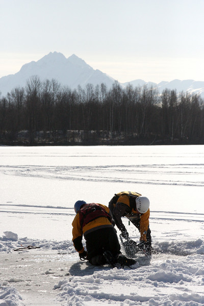 Pioneer Peak fades in the background as Dick Quinn and Cliff Silvers open up the ice.