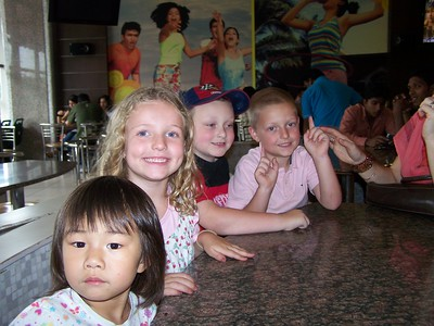 Kaara, Claire, Noah, and Clark at McDonald's at Prasads in Hyderabad