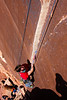 Richard follows up <i>Supercrack 5.10</i> with Tracy at the belay far below.