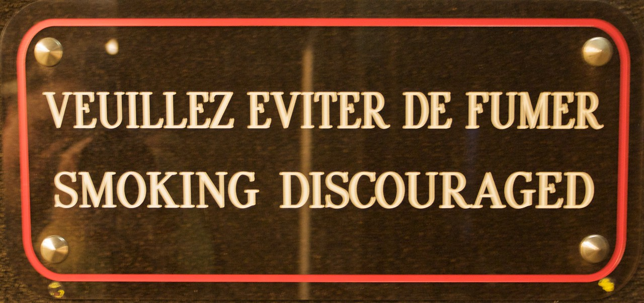 Mealy-mouthed • I saw this sign at several points around the Palais des Nations. I couldn't help but laugh, thinking it quite exemplary of the ultimate impotence of the UN—they can't even specifically tell delegates not to smoke in their building!