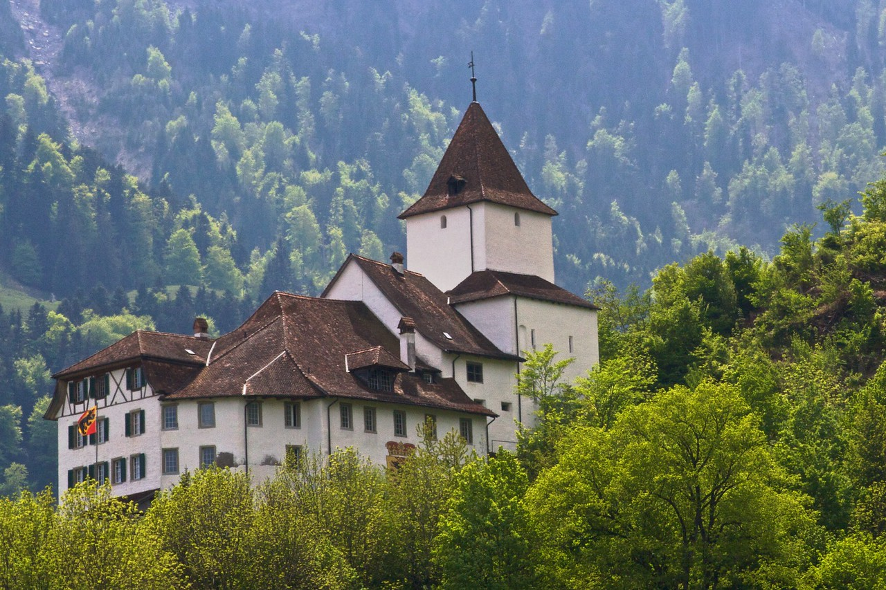 A castle high on a hill in the Bernese Oberland.