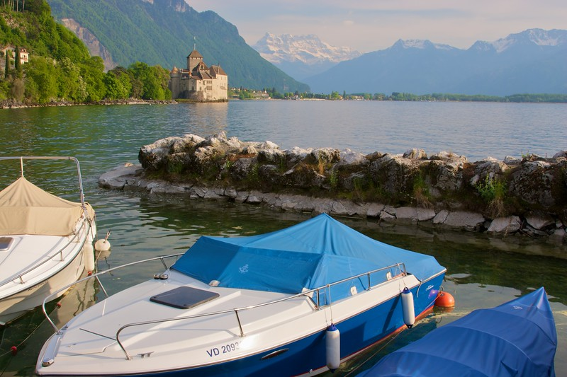 Boats moored at the end of Lake Geneva (Lac Léman), near the Château de Chillon. The Dents du Midi are visibile in the background.