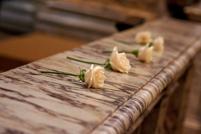 Roses left on the altar by the wedding party.