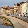 Crossing the Arno on our way into Pisa.