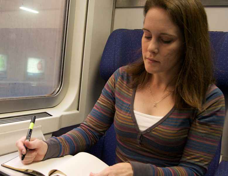 Tessa's catching up on her journal while we ride the train to Pisa.