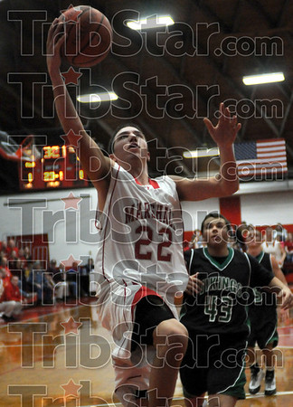 Score: Marshall's #22, Travis Johnson glides to the basket for a score against West Vigo Friday night.