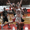 Basketball ballet: Marshall's #10 Logan Eitel has the ball stripped away as he goes up for a shot attempt against West Vigo Friday night.