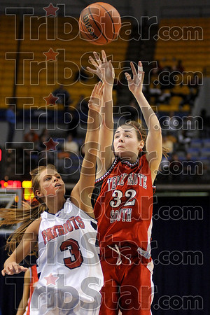 Terre Haute South's Krista Smith takes the jumpshot over North's Kyleigh Brown during the Braves' win Friday at Hulman Center.