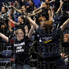 "Members of the Terre Haute North Patriot Pep Band dance along to the Village People's ""YMCA"" during the North-South game Friday at Hulman Center."
