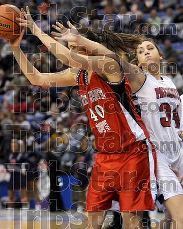 Disrupt the pass: Terre Haute North's Emily Adams, right, tries to stop a pass by South's Dragana Grbic during the teams' game Friday at Hulman Center.