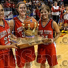 To the southside: Terre Haute South seniors Jordan Smith, Emily Fauber and Megan Craft accept the trophy for the Braves after their win over North Friday at Hulman Center.