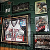 Tribute: Photographs and memorabilia depict the sports life of Travis J. Smith in Beef O'Brady's restaurant.