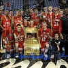 The Terre Haute South boys basketball team poses with the North-South basketball trophy Friday after the Braves defeated North at Hulman Center.