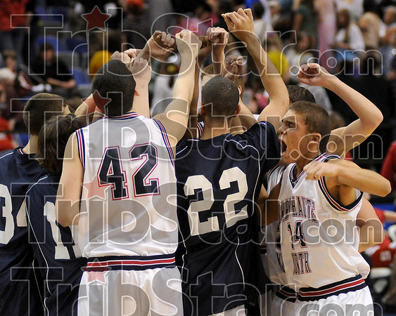 Terre Haute North's Cory Hemmings, right, huddles with his teammates before the start of the North-South basketball game Friday at Hulman Center.