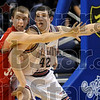 Don't let the pass get past: Terre Haute South's Austin Weaver tries to block any passes to North's Thomas Anderson during the annual North-South game Friday at Hulman Center.