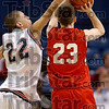 Shot blocker: Terre Haute North's Leylahnd Owens tries to block a jump shot by South's Jake Odum during the Patriots' loss Friday at Hulman Center.