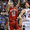 Gotcha!: Terre Haute South's Krista Smith shoots over North's Emily Adams after Smith was able to sidestep Adam's defensive efforts Friday at Hulman Center.