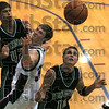 Got it: West Vigo's #14, Jordan Pearson is about to get a rebound during first half action at Riverton Parke Friday night. Riverton Parke's #30, Austin Tewell and West Vigo's #42, Drew Aff watch the action.