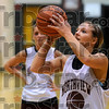Eyes on the prize: Northview's Spring Raines takes a shot as her sister, Stormi, background, looks on during a shooting drill Monday in Brazil at Northview High School.