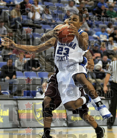 Marshall move: Indiana State's #23, Harry Marshall drives the ball past a Southern Ill. defender during first half action at Hulman Center.