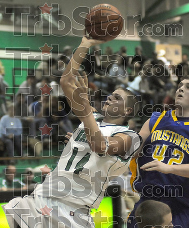 Runner: West Vigo's #14, Jordan Pearson throws up a runner during game action Saturday night against Fountain Central.
