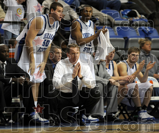 Support: Coach Kevin McKenna applaudes the play of his players in the first half of action against Northern Ill. Saturday night at Hulman Center.