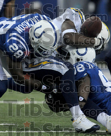 Crunch time: Indianapolis's Marlin Jackson and Robert Mathis sandwich San Diego's LaDainian Tomlinson which forced him to fumble the ball during the Colts' playoff game against the Chargers Sunday in Indianapolis.