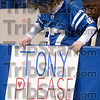 Don't go, coach!: Seven-year-old E.J. White of Carmel attaches his sign to a wall in front of his seat Sunday before the Colts' game against the Chargers in Indianapolis.