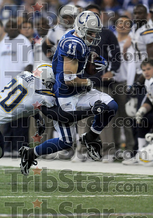 Big play: Indianapolis Colts wide receiver Anthony Gonzalez is tackled by San Diego's Marlon McCree after he caught a Peyton Manning pass Sunday in Indianapolis. Gonzalez maintained his balance and ran the ball into the endzone to score.