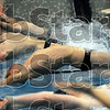 Start: Swimmers leave their marks during a medley relay event of the North/South swim meet Thursday night.