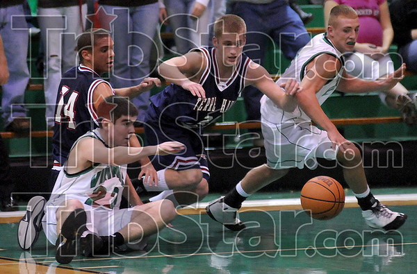 On the loose: Vikings Evan MIller (22) and Tyler Wampler (5) eye the loose ball along with Terre haute North's Cory Hemmings (14) and Chris O'Leary (24).