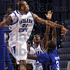 Not in my house: Indiana State's #21, Isiah Martin blocks the shot of Creighton's #3, Cavel Witter during first half action at Hulman Center Wednesday night.