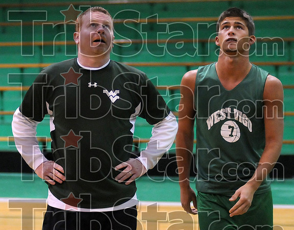 Role model: West Vigo head basketball coach Tommy Thornton said of his player, Ò[Aff] plays the game the way it should be played.Ó Thornton is seen here with Aff watching his teammates shoot free throws at practice.