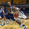 Comin' through: Indiana State's #1, Gabe Moore drives past a Creighton defender during first half action Wednesday night at Hulman Center.