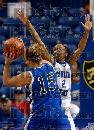 I'll block it!: Indiana State's Annie Bankhead tries to stop a shot by Creighton's Kelsy Crites during the Sycamores' game against the Bluejays Thursday at Hulman Center.