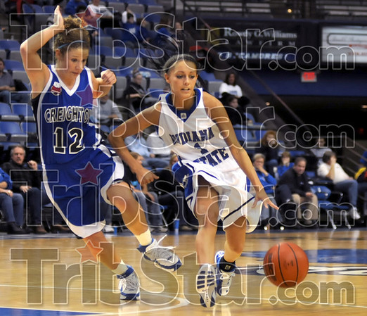 Push: Indiana State's #1, Angela Phillips pushes the ball hard during second half action at Hulman Center Thursday night. Defending for Creighton is #12, Ally Thrall.