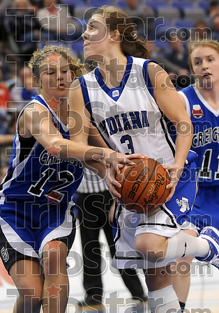 Don't touch: Indiana State's Kelsey Luna drives to the basket as Creighton's Ally Thrall gets a hand on the ball during the Sycamores' loss Thursday at Hulman Center.