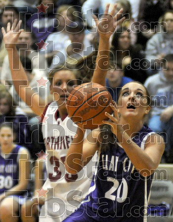 Open: Clay City's #20, Angie Camp drives the ball past Northview's #33, Stormi Raines Tuesday night at the Northview gym.