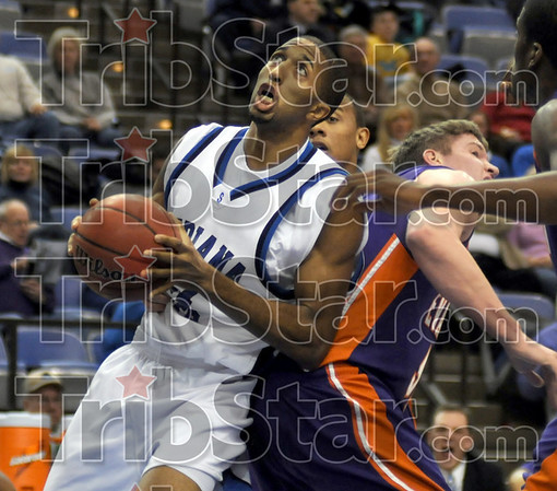 Bounder: Indiana State's #21, Isiah Martin gets bumped from behind after snaring a rebound during game action against Evansville Thursday night at Hulman Center.