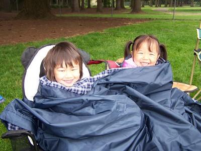 Kaara and Jillian snuggle up at Noah's baseball game.