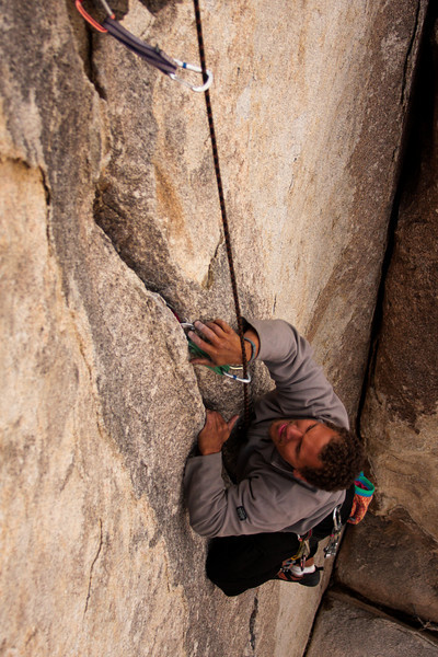Kelsey works to jam his huge fingers into the tiny crack of <i>Exorcist 5.10</i>.
