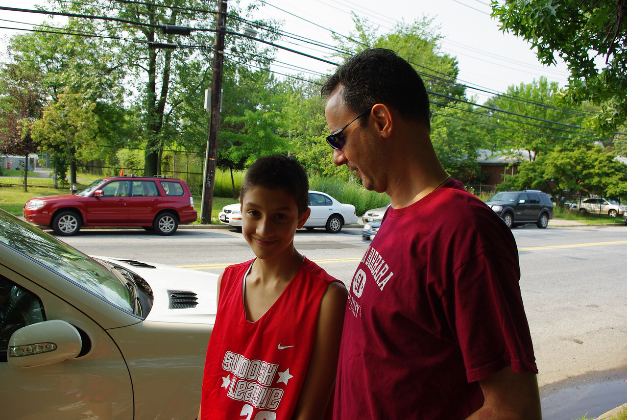 Nikhil getting a pep talk from Pops (my brother Larry.)