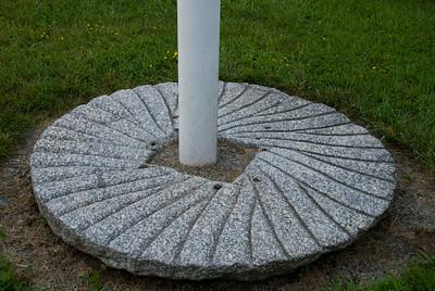 Base of the flagpole.