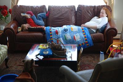 just chillin' on da couch. Reading a book. True, true.
