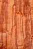 Water streaks create beautiful art on the sandstone walls of Arches National Park.