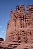 The fisher Towers rise magnificently over the desert, with two parties climbing <i>Stolen Chimney 5.10</i> on the Ancient Art formation.