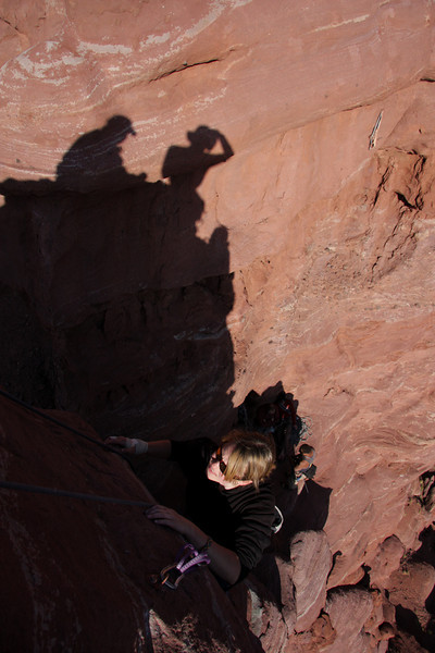 Jess Young nears the top of the third pitch of <i>Stolen Chimney 5.10</i>.