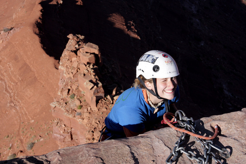Tracy fires off a nervous grin as she descends into the shadow of Castleton Tower.