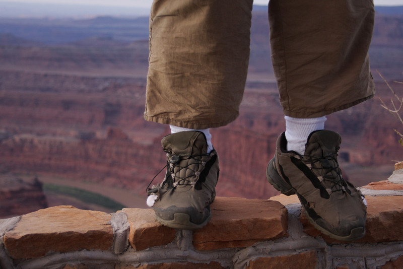Kelsey's hard-working toes protrude through his well-worn shoes on the edge of Dead Horse Point.