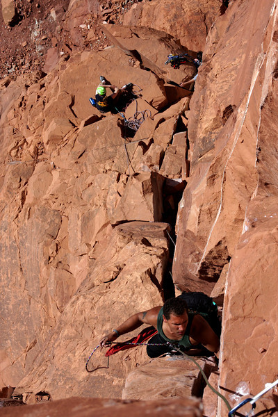 Kelsey Gray follows us up using a toprope self-belay to save time in such a large party.